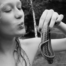 Girl kissing snake